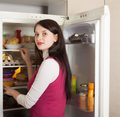 woman looking for something  in fridge
