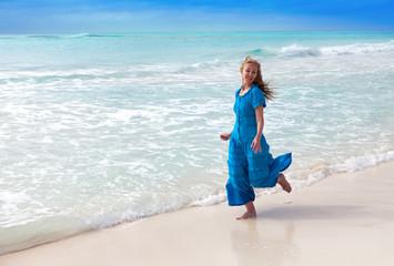 The  happy woman on sea coast..
