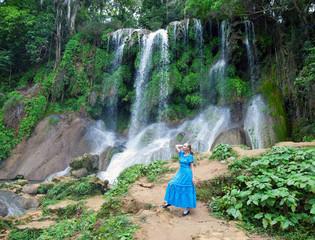 woman in  long dress near waterfalls Soroa,Pinar del Rio,Cuba