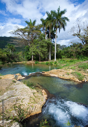 The river with stages in park of Soroa. Cuba. - 69728985