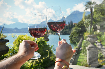 Wineglasses against lake Como, Italy