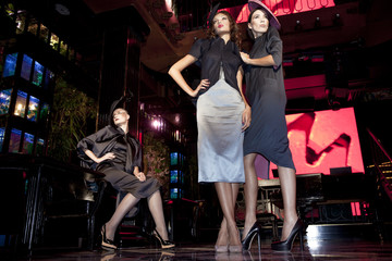 Three beautiful models in a stylish designer clothes