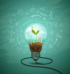 Green seedlings in a light bulb ecology concept