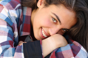 Beautiful teenager girl smiling and looking at camera