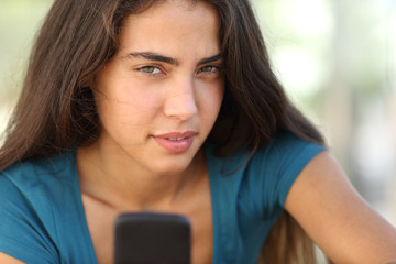 Portrait of a teen girl with a smart phone