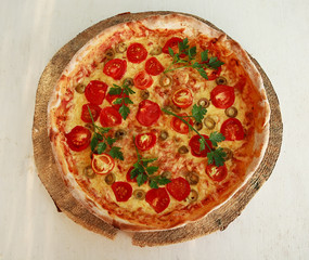 Delicious fresh pizza served on wooden plate