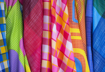 Clothes in scott pattern and dot pattern in fabric shops.