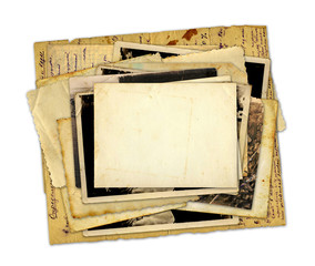 Pile of old photos and letters on white background isolated