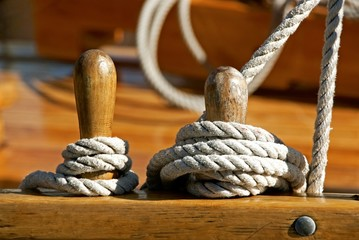 Detail of ropes and bollards on sailing ship.