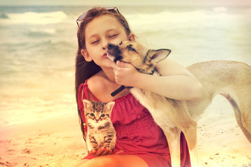 child and dog and cat