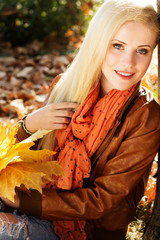 Nice blonde girl in autumn park