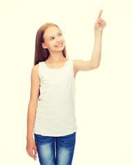 girl in blank white shirt pointing to something