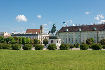 Equestrian statue at Heldenplatz with Minoritenkirche Church in