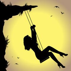 silhouette di donna in altalena