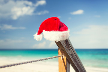 close up of santa helper hat on beach