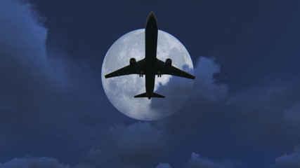 Plane taking off at night with a full moon background