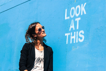 "Hipster model wearing sunglasses posing next to ""Look at This"""