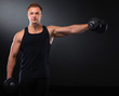 canvas print picture - Fit muscular man exercising with dumbbell