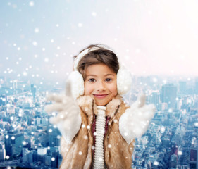 smiling little girl in winter clothes