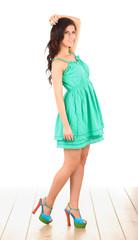 Fashion model wearing green dress