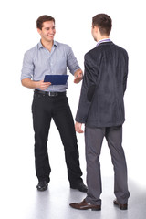 Two business men shaking hands and one of them holding a folder