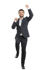 excited young businessman dancing