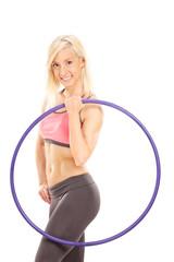 Female athlete holding a plastic hula hoop