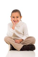little girl sitting on white