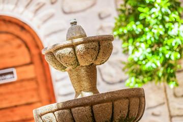 A designed stone fountain in the backyard