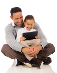 father with his little girl using tablet computer