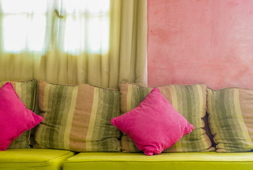Bright colorful cushions on the sofa