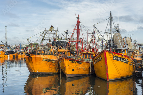 Orange fishing boats in Mar del Plata, Argentina © Anibal Trejo