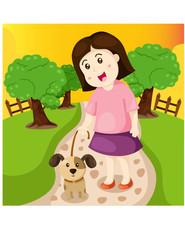 girl walking dog in the park