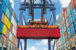 Shore crane lifts container during cargo operation in port - 69739770