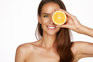Beautiful woman holding orange healthy eating organic food diet