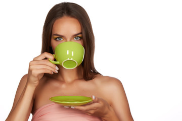 Young beautiful sexy girl holding cup of coffee or tea