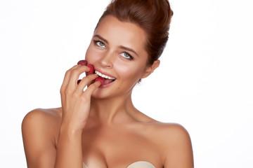 Beautiful sexy woman eating raspberries healthy food organic