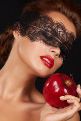 Woman lace on eyes with big red apple passion sex red lips