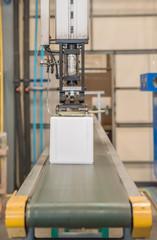 Industrial robot working in plastic factory