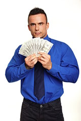 Young man in blue shirt holds and shows you money