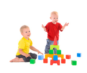 two brothers builds toy building of colored cubes