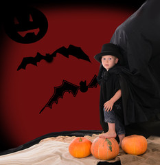 boy in suit of count Dracula on halloween