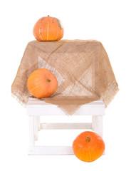 orange ripe pumpkins on linen cloth background