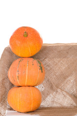 tower of orange pumpkins on linen cloth