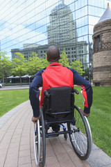 Man in wheelchair with Spinal Meningitis moving independently