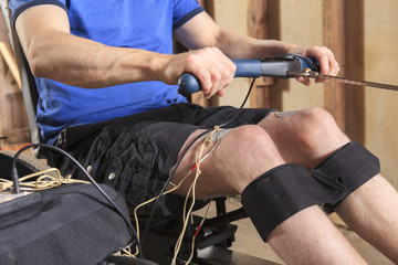 Man with spinal cord injury using his rowing machine
