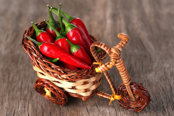 Red hot chili peppers in decorative wicker basket