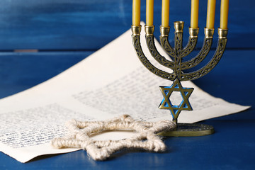 Menorah, star of David and page of Genesis book
