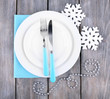 White plates, fork, knife and Christmas tree decoration