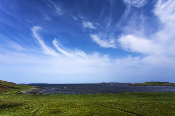cirrus clouds over L'Anse aux Meadows, Newfoundland